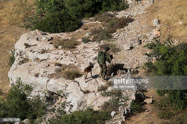 Israeli soldiers conduct a search mission during the fifth day into the search of three missing teenagers June 17 2014 in Hebron West Bank Israeli...