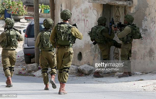 Israeli soldiers conduct searches in the northern West Bank village of Madama on August 24 2016 after a Palestinian reportedly exited a car and...