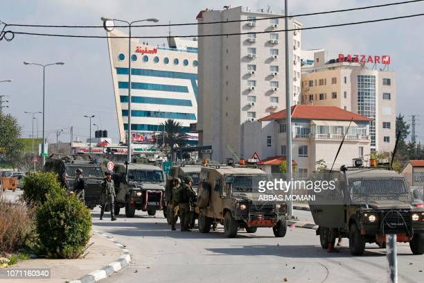 Israeli soldiers deploy during clashes in the West Bank city of Ramallah following a raid on December 10 one day after a driveby shooting attack next...