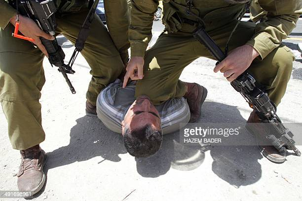 Israeli soldiers detain a Palestinian protester during a gathering by Palestinian Israeli and foreign demonstrators in support of Palestinian...