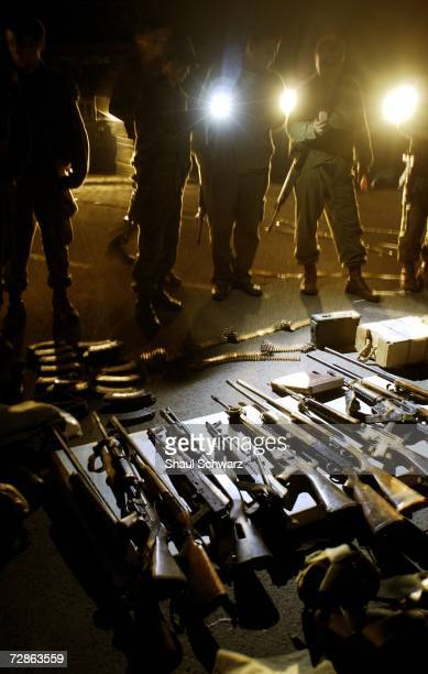 Israeli soldiers display weapons of Hezbollah guerillas killed in clashes in southern Lebanon early July 26 2006 on the IsraeliLebanese border near...