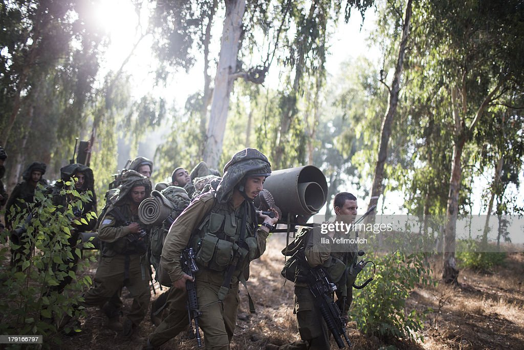 Israeli soldiers during a military exercise on September 1, 2013 near the border with Syria, in the Israeli-annexed Golan Heights. Tension's are rising in Israel amid international talks of a military intervention In Syria.