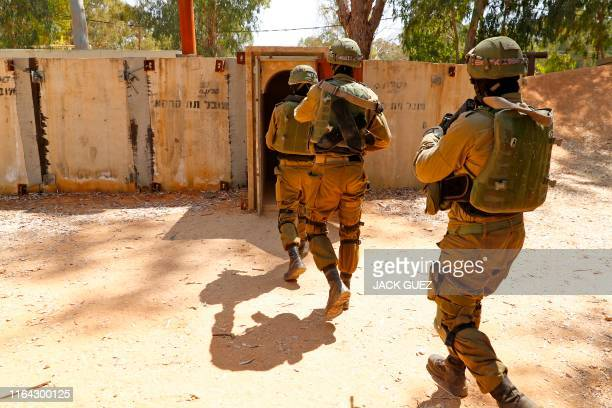 Israeli soldiers enter a physical mockup enemy tunnel, to take part in combat exercise, at an Israeli Army base in Petah Tikva, northeast of Tel...