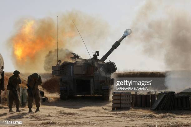 Israeli soldiers fire a 155mm self-propelled howitzer towards targets in the Gaza Strip from their position near the southern Israeli city of Sderot...