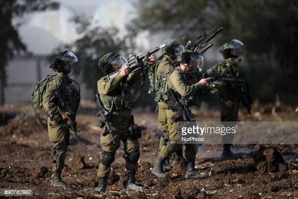 Israeli soldiers fire tear gas towards Palestinian protesters during a demonstration against US President Donald Trump's recognition of Jerusalem as...