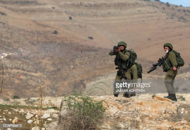 Israeli soldiers fire teargas cannisters against Palestinian demonstrators during a protest against Jewish settlements on November 24 in the Jordan...