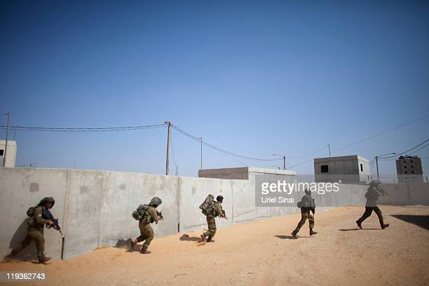 Israeli soldiers from the Bedouin reconnaissance battalion use paintball rifles as they take part in urban warfare training July 19 2011 in the...