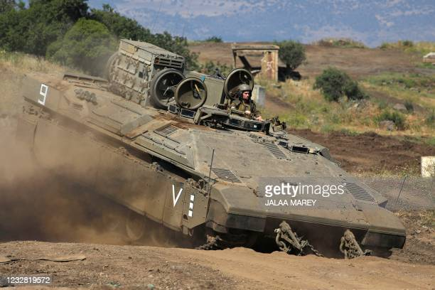 Israeli soldiers from the Golani Brigade take part in a drill near Moshav Odem in the Israeli-annexed Golan Heights on May 11, 2021.