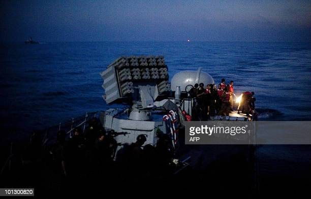 Israeli soldiers get ready to disembark from a missile ship as the Israeli navy intercepts a Gazabound aid flotilla in the Mediterranean Sea on May...