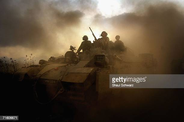 Israeli soldiers get ready to enter Lebanon August 8 2006 on the IsraelLebanon border Israel Hezballoh missiles continue to fall throughout the north...