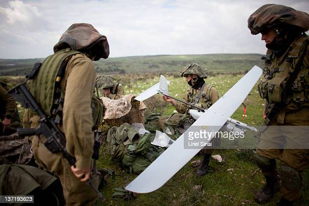 Israeli soldiers get ready to launch the Skylark drone during a drill on January 16 2012 near Bat Shlomo Israel The Skylark can carry a camera...