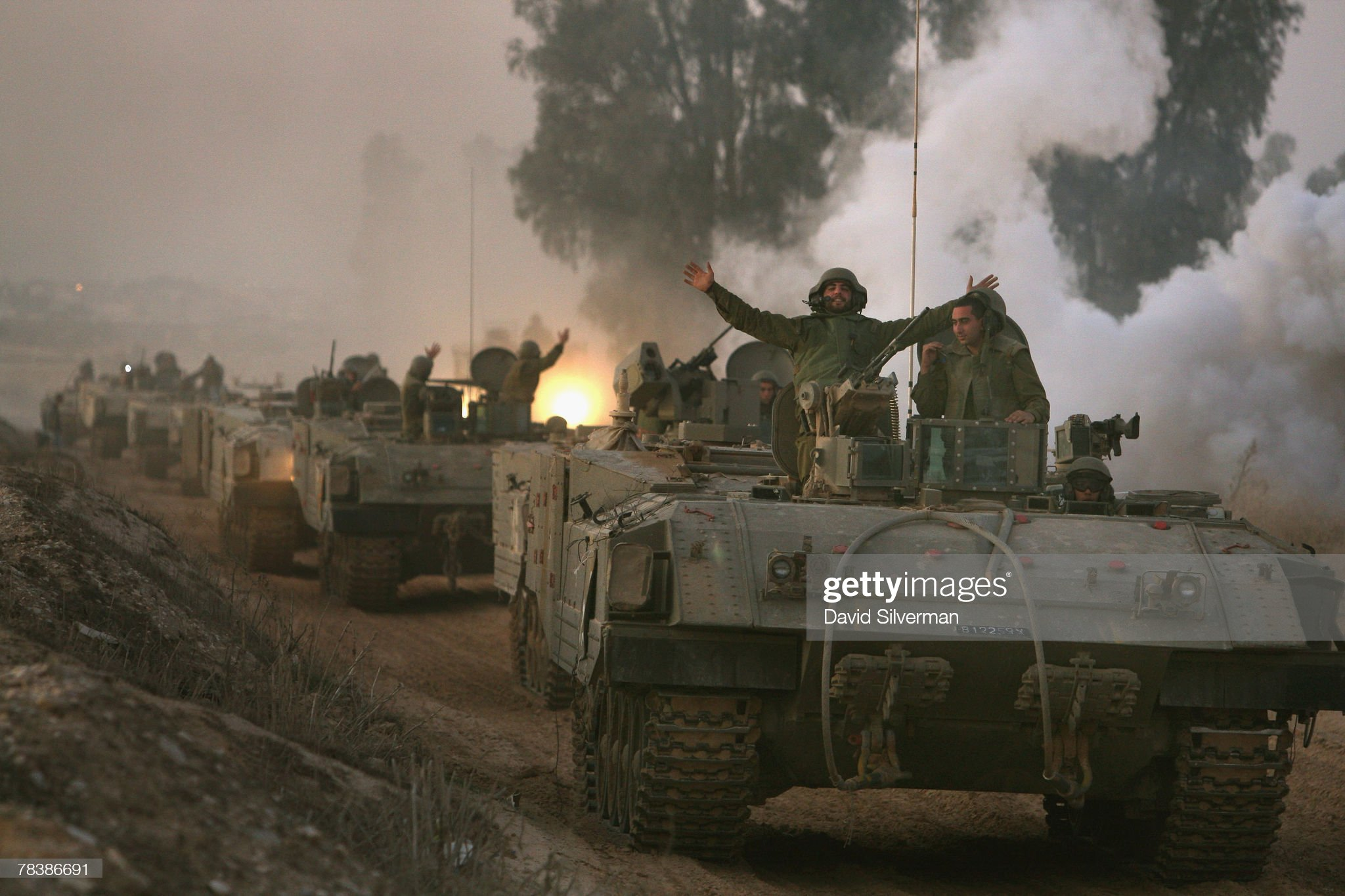 israeli-soldiers-in-a-convoy-of-armoured-vehicles-celebrate-their-picture-id78386691?s=2048x2048