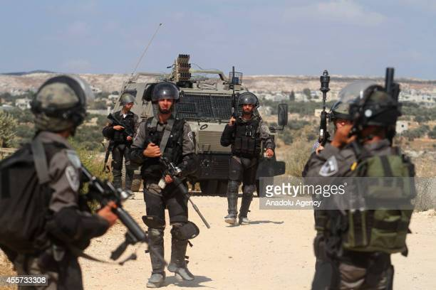 Israeli soldiers in action clashes between Israeli soldiers and Palestinians following a protest against the Jewish settlements and the Israeli Wall...