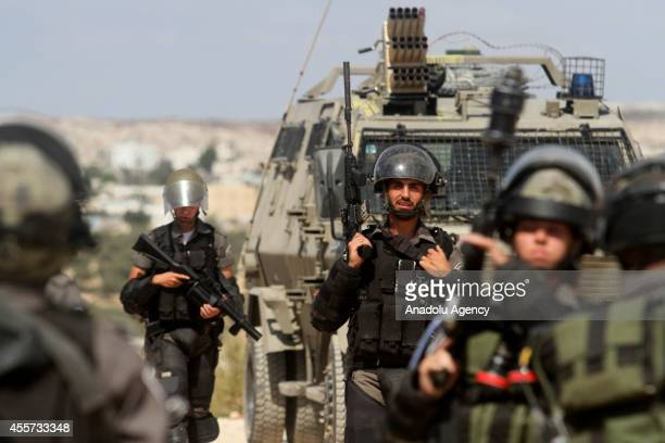 Israeli soldiers in action clashes with Palestinians following a protest against the Jewish settlements and the Israeli Wall of Shame the separation...