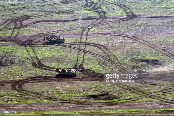 Israeli soldiers in their Armored Personnel Carriers attend a military exercise near the Israeli town of Katzrin in the Israelioccupied Golan Heights...
