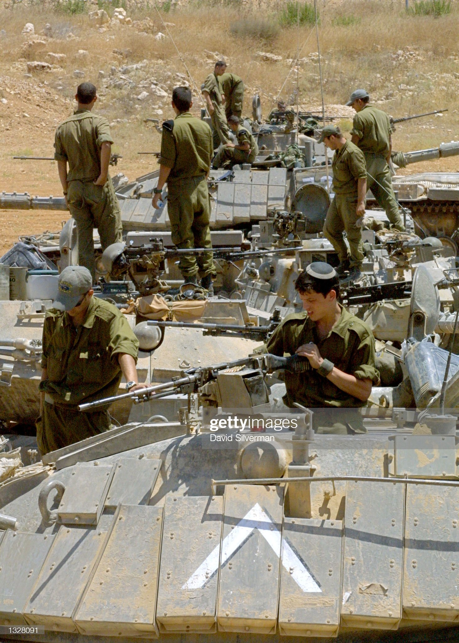 https://media.gettyimages.com/photos/israeli-soldiers-inspects-the-weapons-on-their-m60-tanks-after-their-picture-id1328091?s=2048x2048