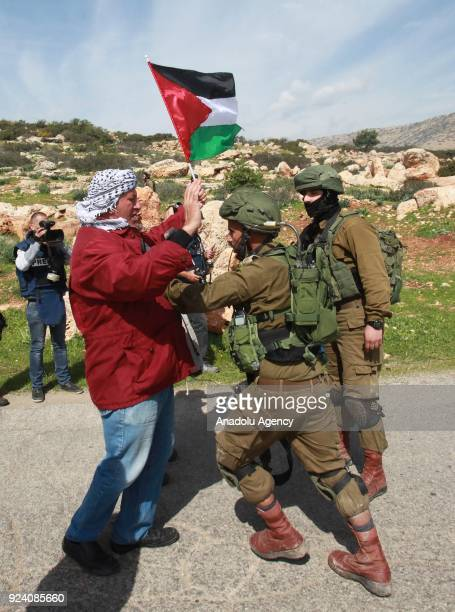 Israeli soldiers intervene in a protest by Palestinians against Jewish settlers seizing lands in the area near Tubas West Bank on February 25 2018