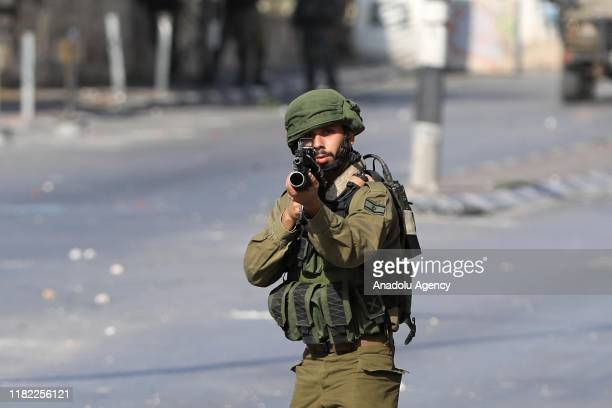 Israeli soldiers intervene in Palestinian demonstrators during a demonstration to protest against Israeli attacks towards Gaza in Bethlehem West Bank...