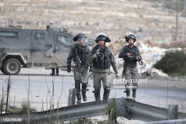 Israeli soldiers intervene in Palestinian demonstrators, gathered at Beit El military checkpoint, using tear gas and blast bombs during a protest...