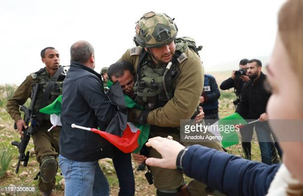 Israeli soldiers intervene in Palestinians during a protest against US President Donald Trump's peace plan in Jordan Valley West Bank on January 29...