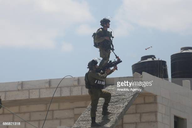 Israeli soldiers intervene in Palestinians who stage a demonstration in support of Palestinian prisoners held in Israeli jails at Qalandia Refugee...