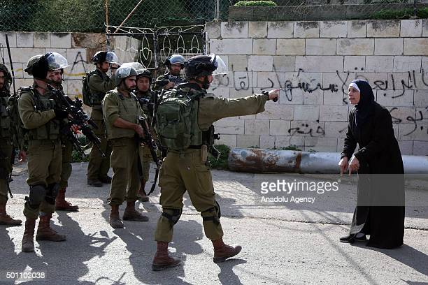 Israeli soldiers intervene to Palestinian woman during a protest after Israel closed the entrance of Aboud village with soil in Ramallah West Bank on...