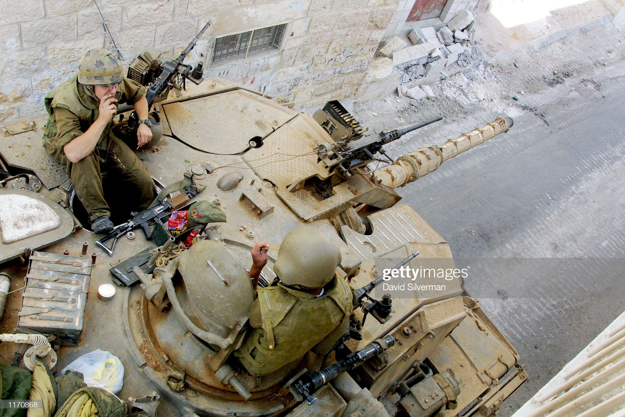 https://media.gettyimages.com/photos/israeli-soldiers-keep-their-turret-aimed-down-a-beit-jala-alleyway-picture-id1170868?s=2048x2048