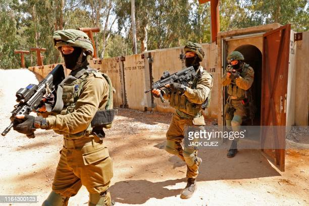 Israeli soldiers leave a physical mockup enemy tunnel after taking part in combat exercise at an Israeli Army base in Petah Tikva northeast of Tel...