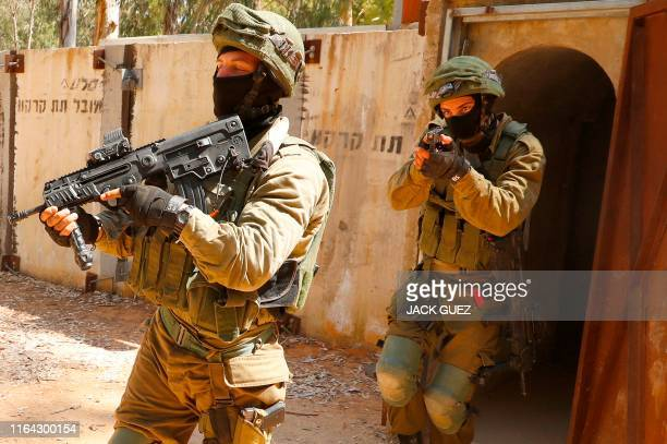 Israeli soldiers leave a physical mockup enemy tunnel, after taking part in combat exercise, at an Israeli Army base in Petah Tikva, northeast of Tel...