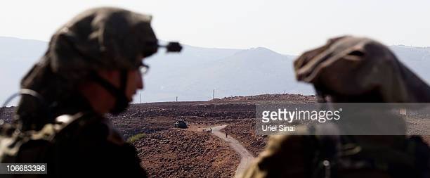 Israeli soldiers look at Lebanese soldiers on the other side of the border November 10 2010 in the village of Ghajar on IsraeliLebanese border...