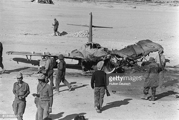 Israeli soldiers look at the burnt Egyptian aircraft at Al Arish airport in Sinai during the SixDay War | Location Al Arish Egypt