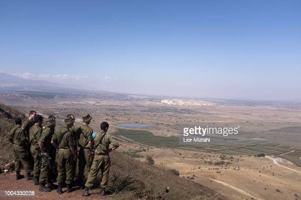 Israeli soldiers look out towards Syria from an observation next to the Syrian border on July 23 2018 in Golan Hights Israel Russian planes bombed...