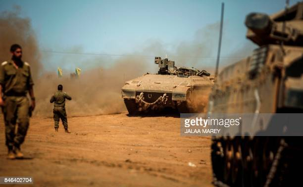 Israeli soldiers manuever a Namer armored personnel carrier and Merkava tanks during the last day of a military exercise in the northern part of the...
