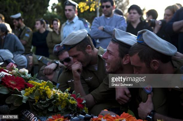 Israeli soldiers mourn during the funeral of their comrade Staff Sgt Alex Mashavisky on January 7 2009 at the military cemetery in the southern...