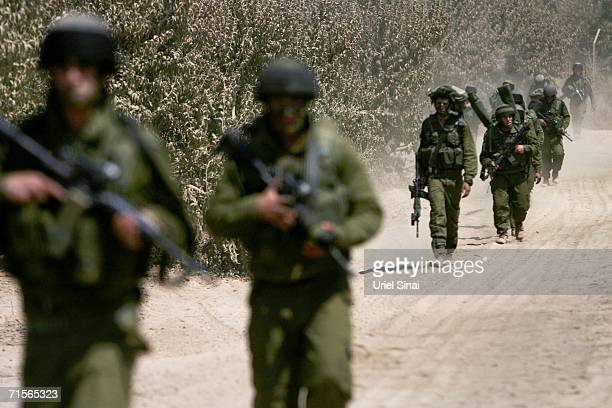 Israeli soldiers move toward the Lebanese border during a mission August 1, 2006 on the Israeli-Lebanese border. Israel has reportedly widened its...