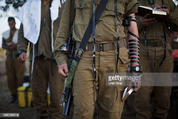 Israeli soldiers of the Golani brigade pray while taking part in a military exercise May 7 2013 near the border with Syria in the Israeliannexed...