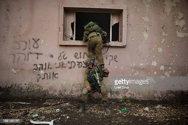 Israeli soldiers of the Golani brigade take part in an exercise near the border with Syria on May 6, 2013 at the Israeli-annexed Golan Heights. Syria...