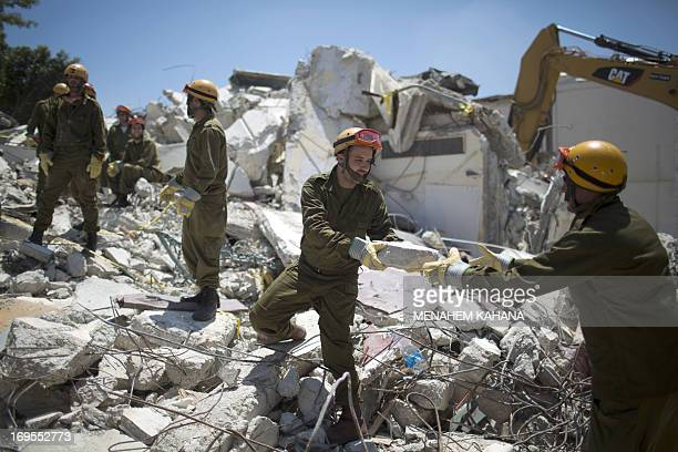Israeli soldiers of the Home Front Command rescue unit take part in a search and rescue drill in the rubble of a building in the northern Israeli...