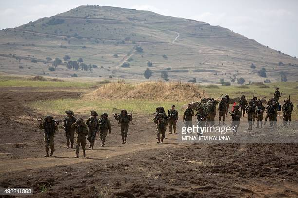 Israeli soldiers of the Jewish UltraOrthodox battalion 'Netzah Yehuda' take part in their annual unit training in the Israeli annexed Golan Heights...