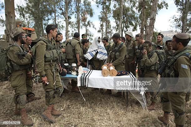 Israeli soldiers of the Jewish UltraOrthodox battalion Netzah Yehuda hold morning prayers as they take part in their annual unit training in the...