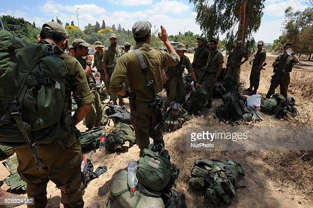 Israeli soldiers on the move to an army deployment area near Israel's border with the Gaza Strip on July 18 2014 Israel has launched a ground...