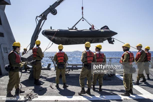 """Israeli soldiers onboard the Israeli vessel Saar 5 Class Corvette """"INS Hanit"""" prepare an inflatable boat during the """"Novel Dina 17"""" exercise in the..."""