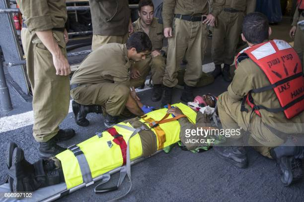 """Israeli soldiers onboard the Israeli vessel Saar 5 Class Corvette """"INS Hanit"""" attend a medical training session during the """"Novel Dina 17"""" exercise..."""