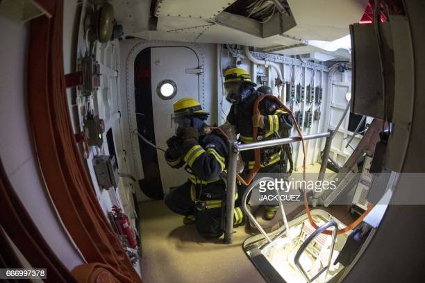 """Israeli soldiers onboard the Israeli vessel Saar 5 Class Corvette """"INS Hanit"""" take part in a fire evacuation excercise during the """"Novel Dina 17""""..."""
