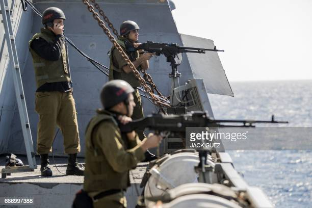 """Israeli soldiers onboard the Israeli vessel Saar 5 Class Corvette """"INS Hanit"""" take part in the """"Novel Dina 17"""" training session in the Mediterranean..."""