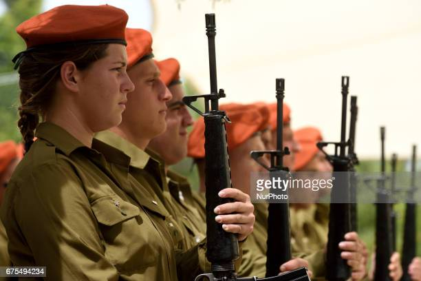 Israeli soldiers participate in an official ceremony marking Israel's Memorial Day one day ahead of Israel's 69'th Indepedence Day in Kiryat Shaul...