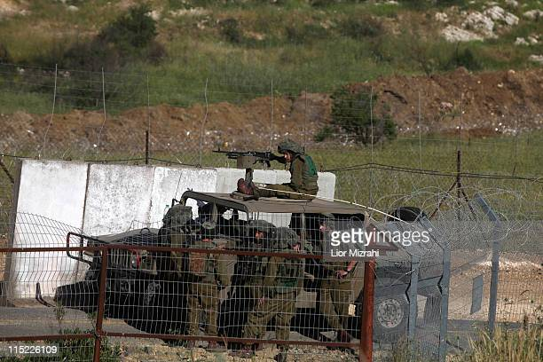 Israeli soldiers patrol along the border fence between the Israeli-annexed Golan Heights and Syria on June 4, 2011 near the Druze village of Majdal...