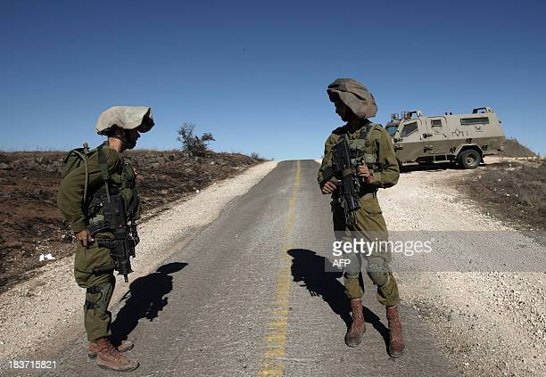 Israeli soldiers patrol on October 9 2013 along the IsraelSyria border after mortar fire from inside wartorn Syria hit the Israelioccupied Golan...