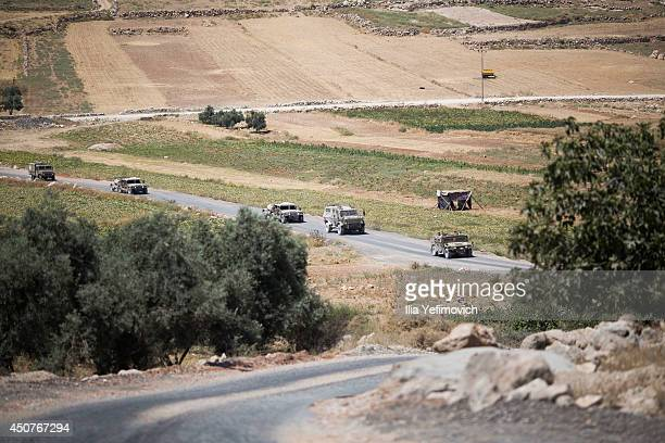 Israeli soldiers patrol the fields outside Hebron during the fifth day into the search of three missing teenagers June 17 2014 in Hebron West Bank...