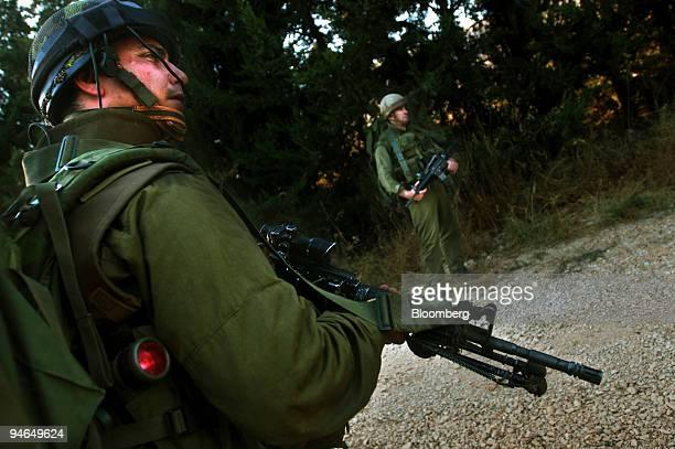 Israeli soldiers patrol the IsraeliLebanese border Tuesday July 25 2006 US Secretary of State Condoleezza Rice and Israeli Prime Minister Ehud Olmert...